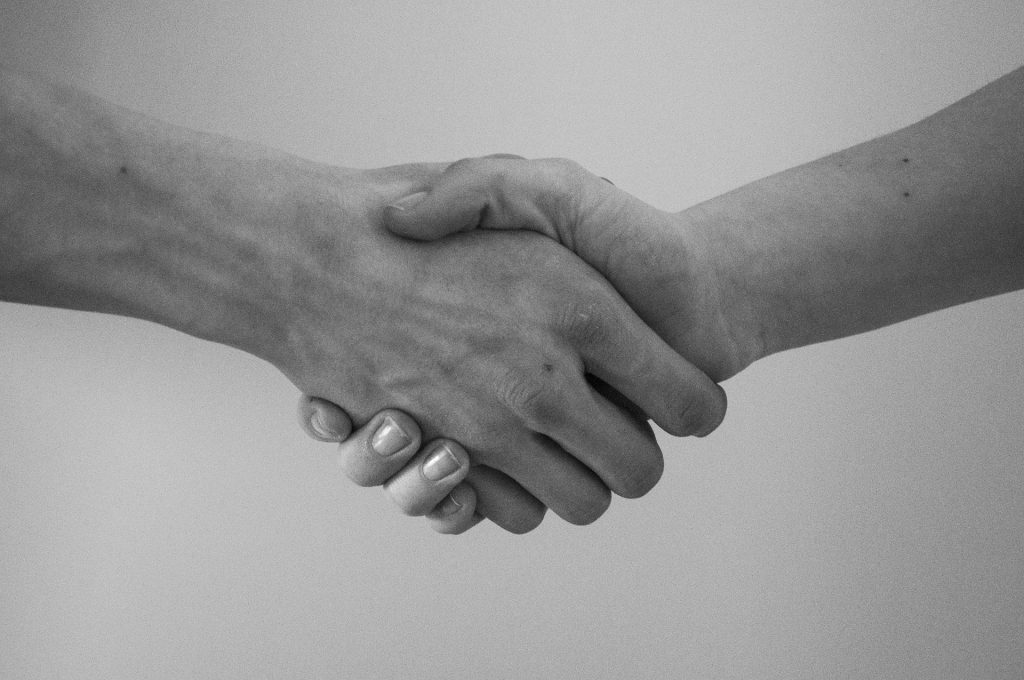 Our Terms of Service is a friendly agreement between us, intended to keep both our interests safe. This picture is of us shaking hands.