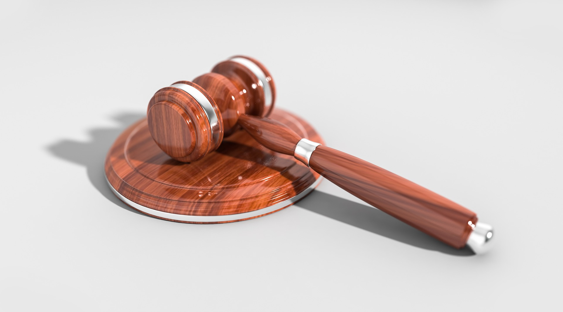 This page is about the terms of service from RdyGo LLC. The picture is of a Gavel seen in a courtroom.