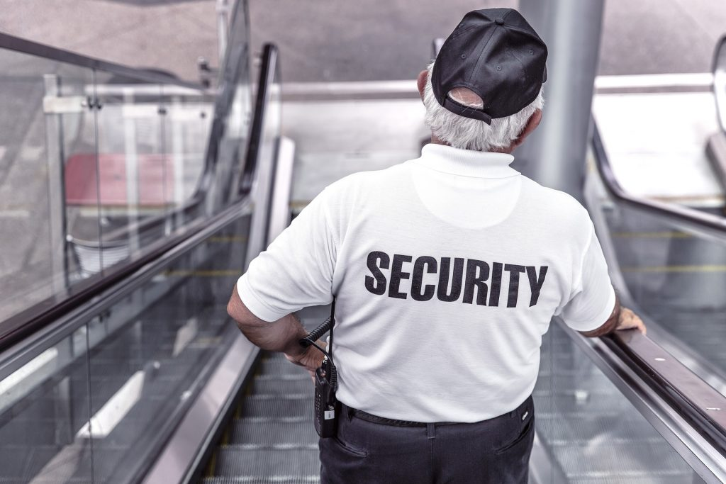 A security guard, trying to track down the answer to this riddle: trouble!